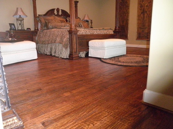 Traditional bedroom decor with red oak hardwood flooring