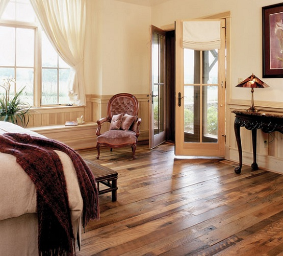 Victorian bedroom style with distressed wood flooring