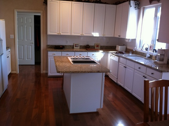 White kitchen cabinet with brazilian walnut flooring