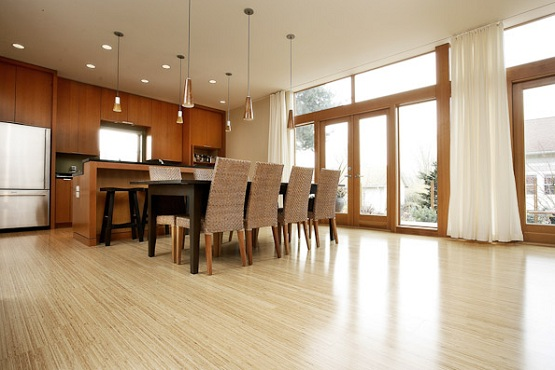 Contemporary kitchen with white bamboo flooring