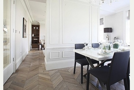 Dining room with reclaimed parquet flooring