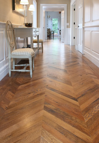 Hallway with reclaimed parquet flooring
