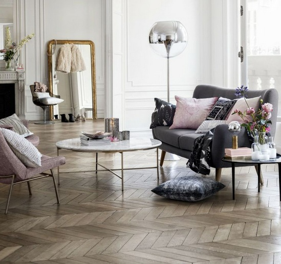 Living room with reclaimed parquet flooring
