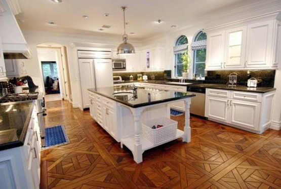 Reclaimed parquet flooring in white kitchen