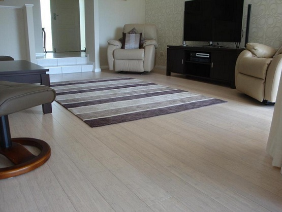 White horizontal bamboo flooring in living room