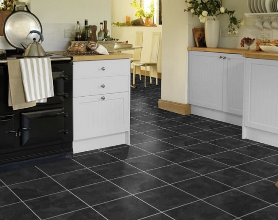 Black tile effect laminate flooring in traditional kitchen design