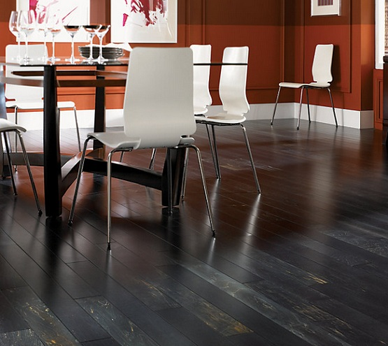 Black wood flooring in dining room