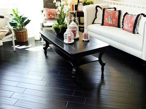 Black wood flooring in small living room