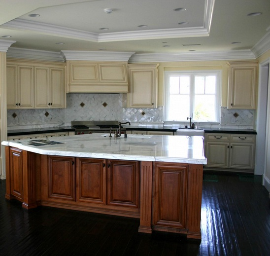 Black wooden laminate flooring in kitchen with granite countertops