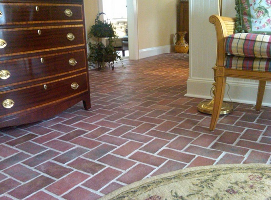 Brick floor tile with herringbone pattern for family room