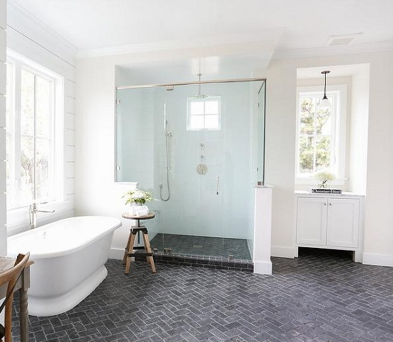 Brick floor tile with herringbone pattern in modern bathroom