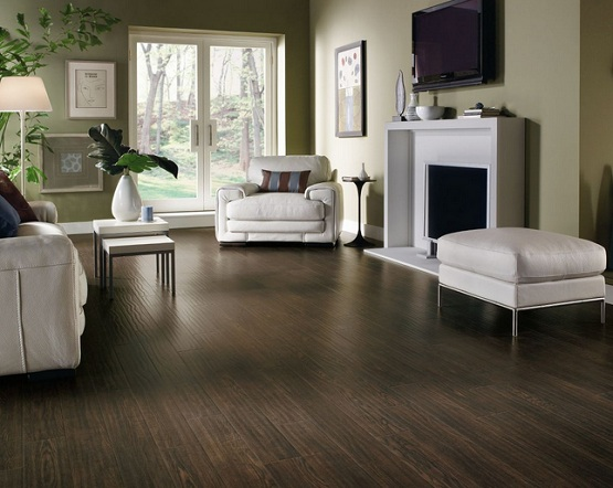 Dark distressed laminate flooring in living room with white furniture