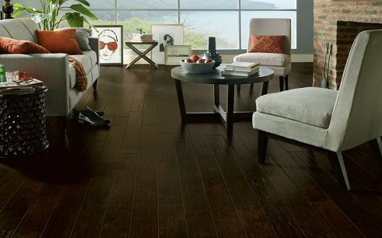 Dark hand scraped laminate flooring for country living room