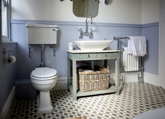 Patterned floor tiles in cottage farmhouse style bathroom