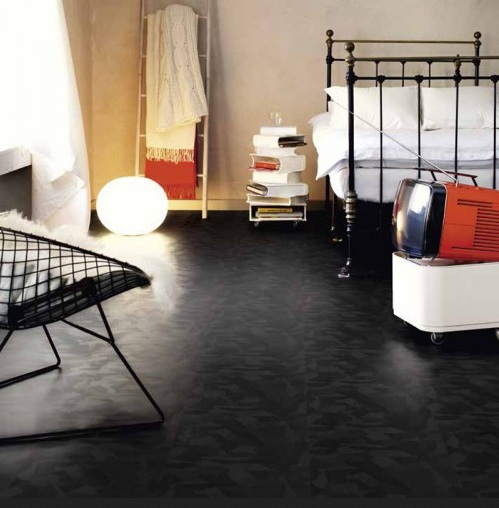 Retro bedroom with black laminate flooring