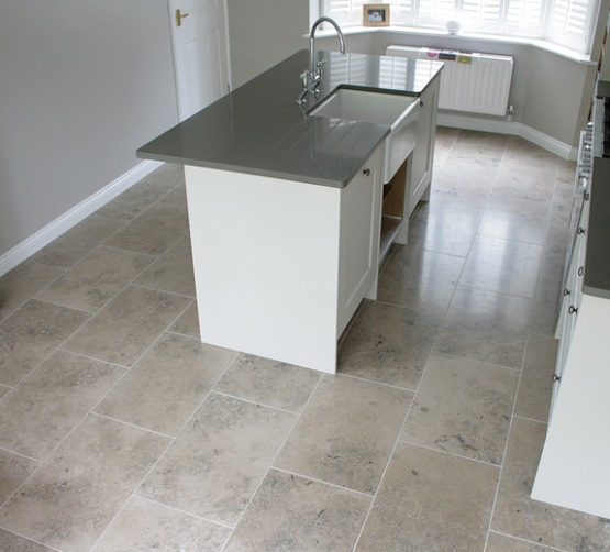 Small kitchen with grey limestone floor tiles