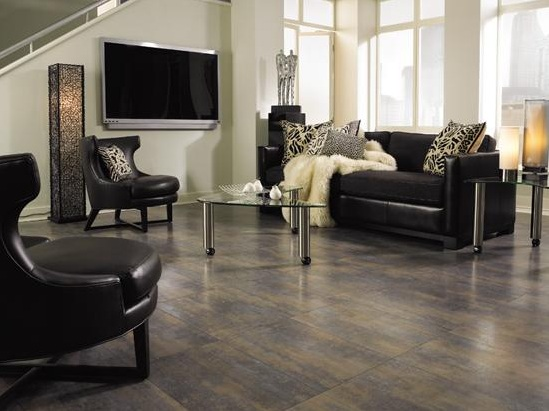 Tile effect laminate flooring in living room with black leather sofa