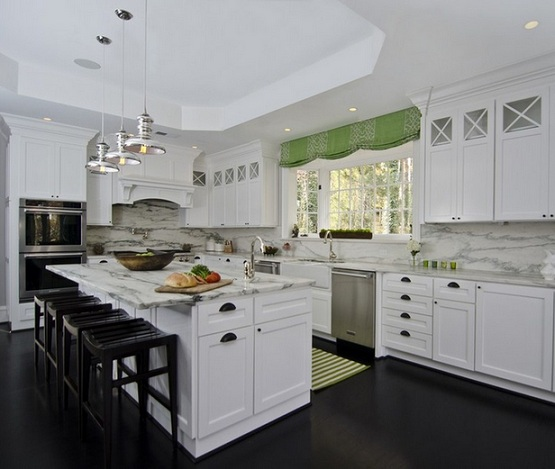 White contemporary kitchen with black laminate flooring