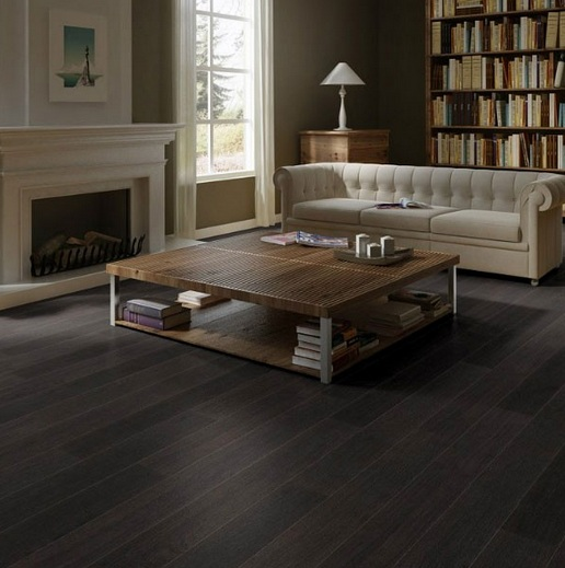 Black oak laminate flooring in living room with light brown sofa