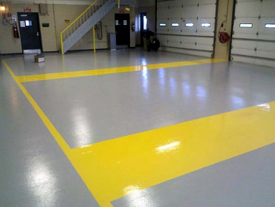 Gray workshop floor paint with yellow border