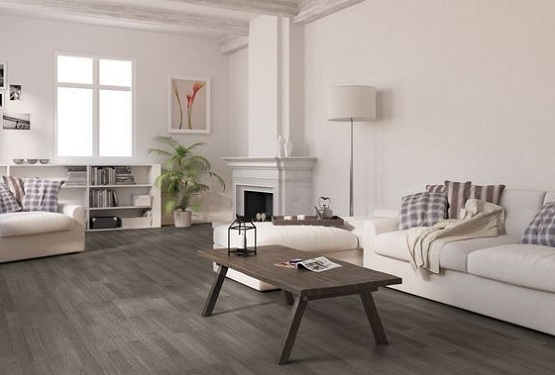 Grey wood laminate flooring in living room with white sofa