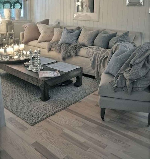 Grey wood laminate flooring in living room with wooden table