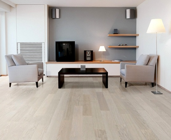 Grey wood laminate flooring with black wooden table