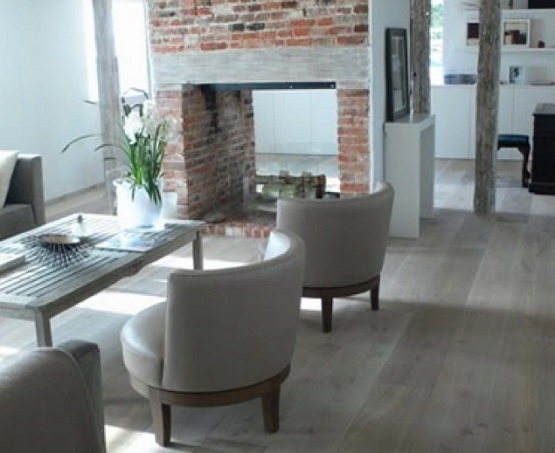 Grey wood laminate flooring with gray furniture