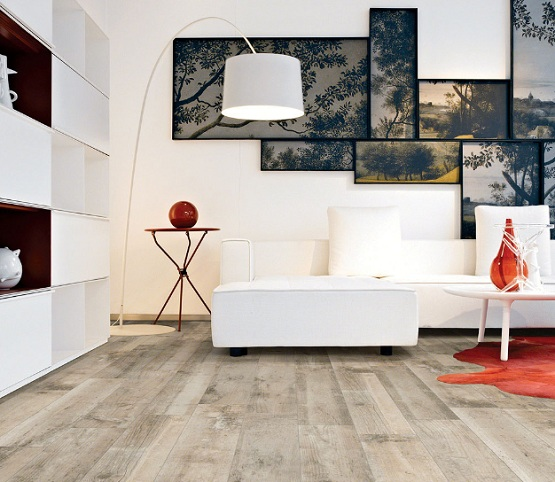 Grey Wood Laminate Flooring With White Living Room Furniture
