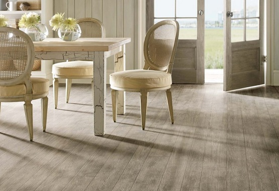 Grey wood laminate flooring with wooden furniture