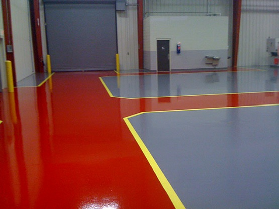 Red and grey workshop floor paint with yellow border