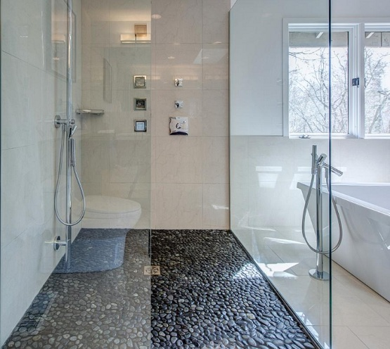 Tight pebble shower floor for contemporary bathroom