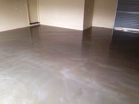 Applying garage floor sealant with epoxy coating