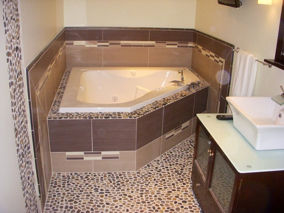 Bathroom with pebble stone flooring