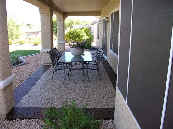 Beautiful pebble stone coating at modern patio design