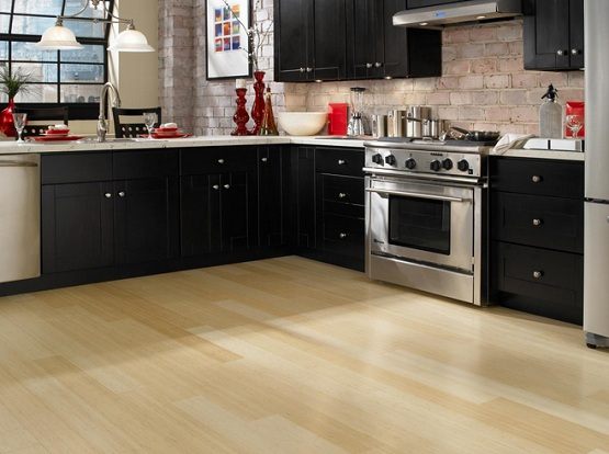 Cream laminate flooring combined with black kitchen cabinet
