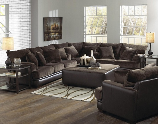 Dark brown laminate flooring in living room with beautiful sofa