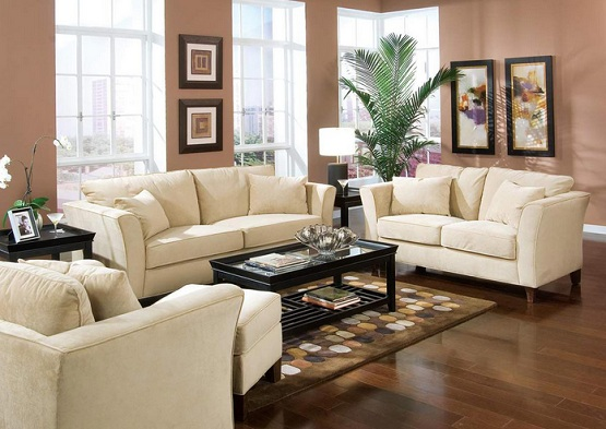 dark brown laminate flooring in small living room with white sofa