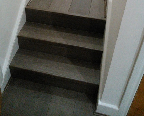 Dark gray laminate flooring for stairs