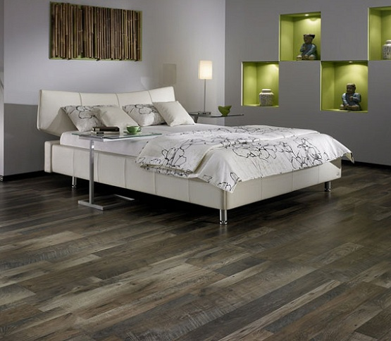 Dark grey laminate flooring in bedroom with white bedding sets