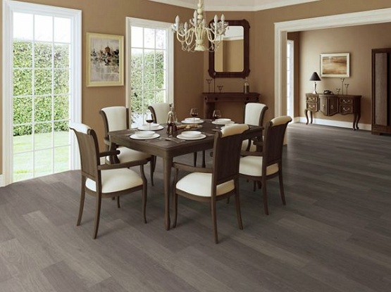 Dark grey laminate flooring in dining room with brown wall paint