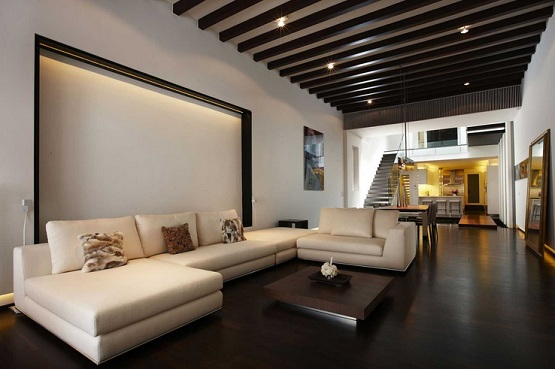 Dark laminate wood flooring in living room with light brown sofa
