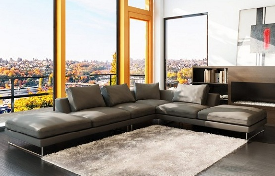 Dark laminate wood flooring in living room with sectional sofa style