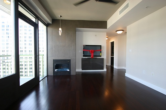 Dark laminate wood flooring in small apartment living room