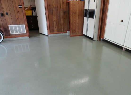 Garage floor sealant with epoxy coating
