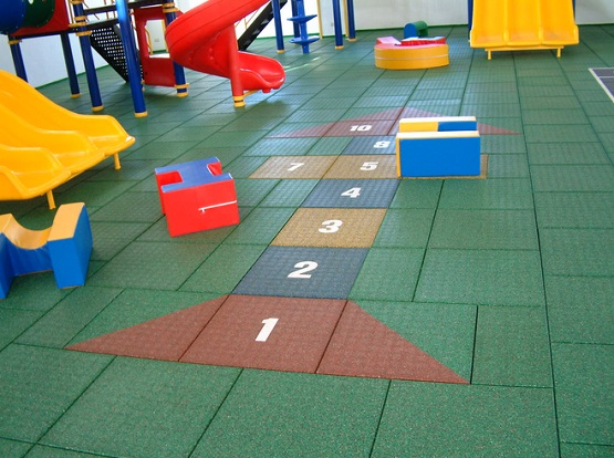Indoor play area with rubber playground mats