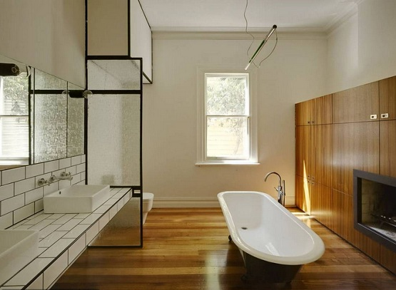 Laminate flooring in bathroom with classic oval bathtub
