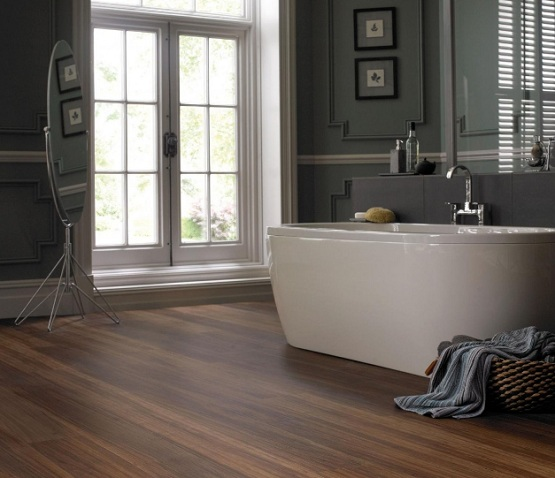 laminate flooring in bathroom with dark gray wall paint - Flooring Bathroom Ideas