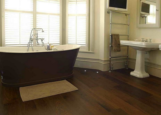 Laminate flooring in bathroom with louvered windows