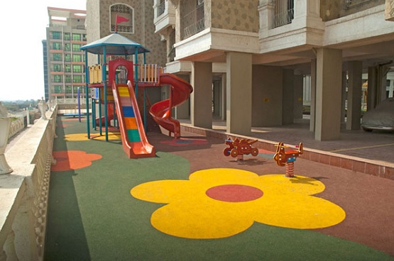 Outdoor play area with rubber playground mats